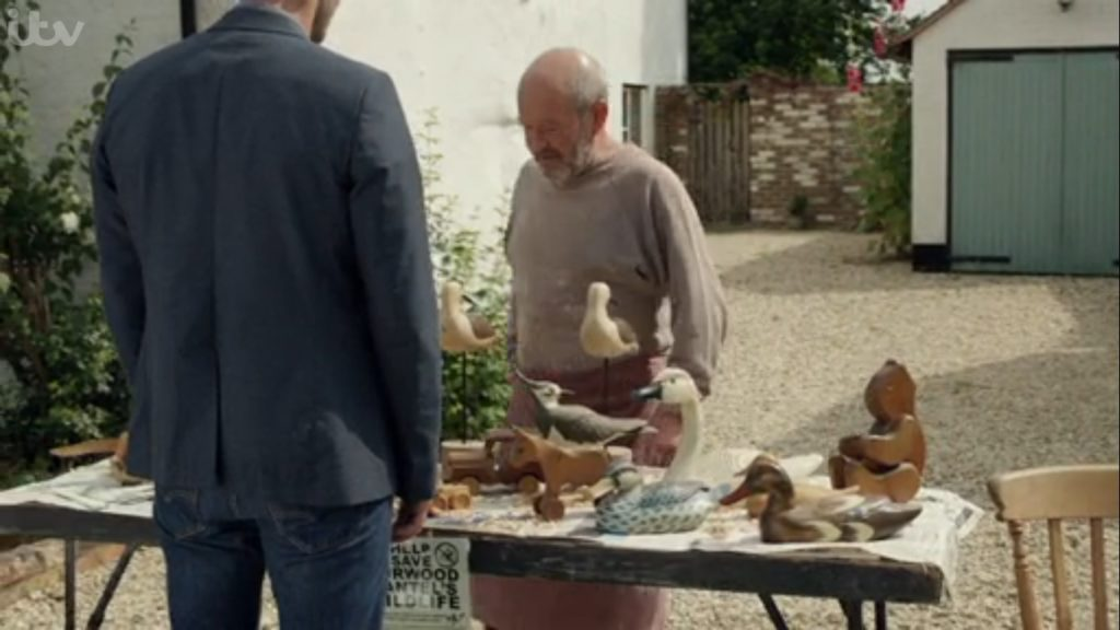 shot from Midsomer Murders of woodcarved birds.